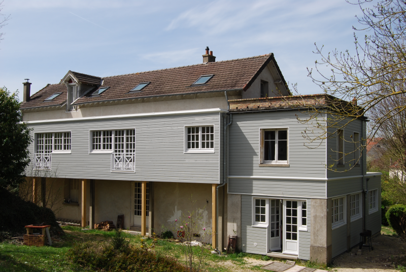 Construction d 39 une double extension en bois pour maison de for Extension maison bois yvelines