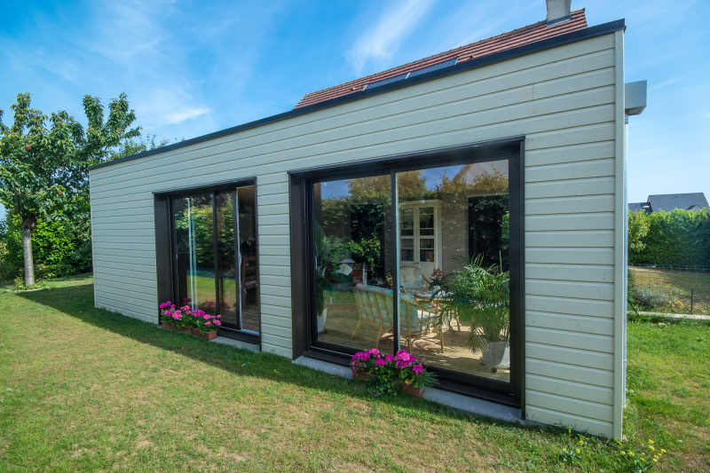 Extension en ossature bois colleville calvados for Prix au m2 extension bois